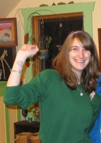 Danya showing her fish tattoo
