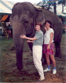 Judy and Salley with elephant at fair, 1991